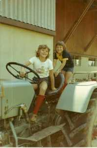 Cha~zay and sister on farm tractor